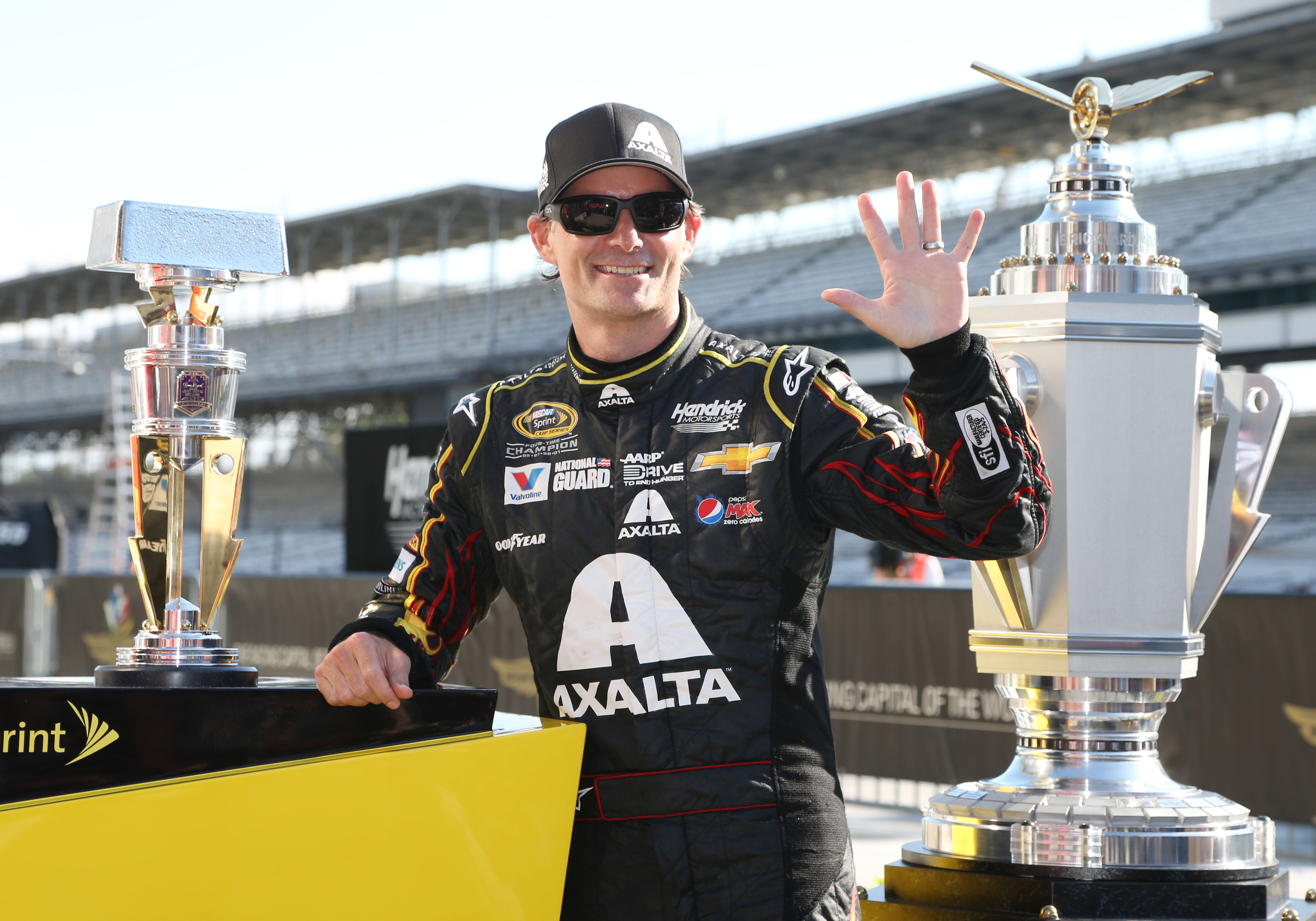 Jul 27, 2014; Speedway, IN, USA; NASCAR Sprint Cup driver Jeff Gordon who is now a five time Brickyard 400 winner holds up 5 fingers after winning the Crown Royal Brickyard 400 at Indianapolis Motor Speedway. Mandatory Credit: Brian Spurlock-USA TODAY Sports